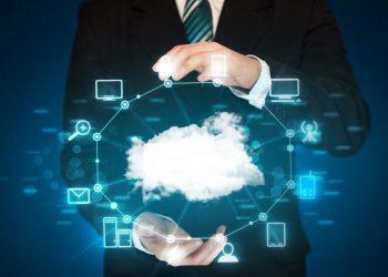 Businessman holding digital icons